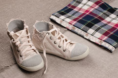 Womens sneakers and plaid shirt with lace insertion. Trendy lace Royalty Free Stock Images