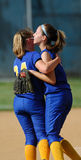 Womens softball celebration. GLOUCESTER, NJ - MAY 25: Two Pennsville High School teammates celebrated after recording an out in the NJSIAA softball playoffs May stock photography