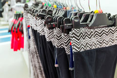 Womens sports pants on hanger in store Stock Image