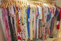 Womens summer clothes hanging on rail Stock Images