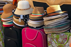 Womens summer hats and bags at the street market Stock Photography