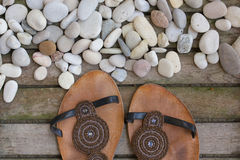 Womens summer shoes on a wooden surface. Background. Leather summer womens shoes on an old wooden surface. Background trend,fashion,season,style,outlook,look stock images