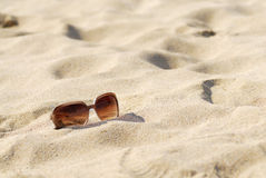 Womens Sunglasses on Sand. Royalty Free Stock Image