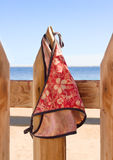 Womens swimsuit hanging on a rope on the fence nea Royalty Free Stock Photography