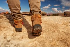 Womens trekking shoes while hiking in mountains.  royalty free stock image