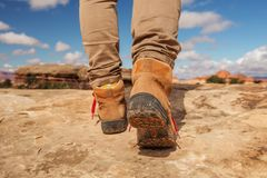 Womens trekking shoes while hiking in mountains.  royalty free stock photos