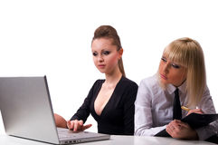 Womens working at the laptop Stock Images