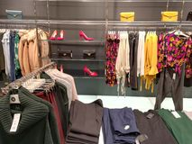 Clothes for women. Womenswear and accessories in a shop Royalty Free Stock Photos