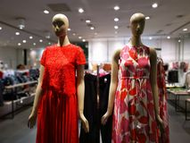 Womenswear spring season dummies in a shop. Beautiful cotton dresses for the spring season stock images