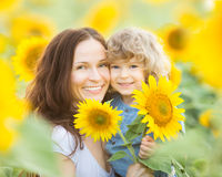 Womn and child in sunflower field Stock Photography
