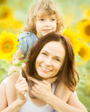 Womn and child in sunflower field Stock Images