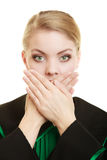 Womn lawyer attorney covering mouth with hands Stock Photos