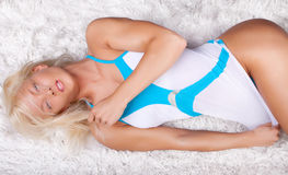 Womna lying on carpet Stock Image