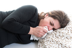 Woman suffering from a cold Stock Images