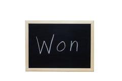 Won écrit avec la craie blanche sur le tableau noir Photo libre de droits