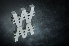 Won Symbol or Sign With Mirror Reflection on Dark Dusty Background stock photos
