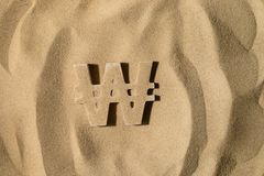 Won Symbol Under the Sand. South Korean Won Symbol or Sign Covered with Sand in the Sun after Crisis royalty free stock photo