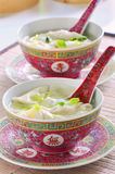 Won Ton Soup. In pretty pink chinese bowls with spoons in vertical format Royalty Free Stock Photo