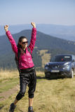 Wonam with arms in the air. Happy hiking with arms in the air Stock Photos