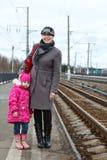 Wonam and child on railway station Royalty Free Stock Photos