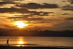 Wondama beach sunset. Wondama sea sunset with mountains as a backdrop. (papua barat, indonesia Royalty Free Stock Images