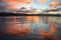 Wondama sea sunset. With mountains as a backdrop. (papua barat, indonesia Stock Photos