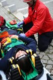Wonded accident person removed from car. A injured person in the interior of crash car with security equipement and firefighters around.nDemonstration of Stock Photos