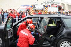 Wonded accident person straped on car interior. A injured person removed from interior of crash car with security equipement and firefighters straped her with Royalty Free Stock Photos