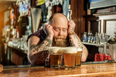 Wonder bearded male watching at beer Royalty Free Stock Photography