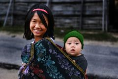 Wonder Of Innocency. A teenage girl carrying her little sister at the remote village of Arunachal Pradesh Royalty Free Stock Photo