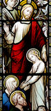 Wonder of Jesus: curing a sick / death  girl in stained glass Stock Image