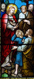 Wonder of Jesus: helping a child. A stained glass photo of a wonder of Jesus Stock Photos