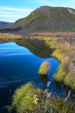 Wonder Lake with hill. Wonder Lake with a hill in autumn Royalty Free Stock Images