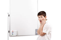 Wonder-struck little boy with white blank board Stock Image