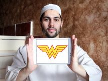 Wonder Woman logo. Logo of Wonder Woman on samsung tablet holded by arab muslim man. Wonder Woman is a fictional superhero appearing in American comic books stock photography