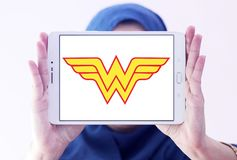 Wonder Woman logo. Logo of Wonder Woman on samsung tablet holded by arab muslim woman. Wonder Woman is a fictional superhero appearing in American comic books stock photo