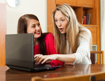 Wonder women looking to laptop at table Royalty Free Stock Photo