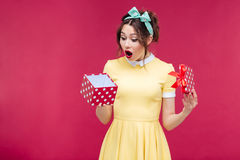 Wondered cute young woman opening gift box Royalty Free Stock Photo