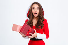 Wondered girl in red santa claus costume opened her present Royalty Free Stock Images