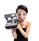 Wondered woman with cassette photographic camera. Isolated on white, wide angle Stock Photos
