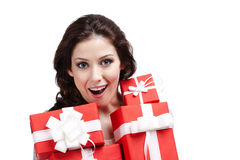 Wondered woman hands a lot of present boxes Royalty Free Stock Images