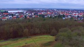 Wonderful aerial 4k drone flight over calm small city cityscape with big mirror surface lake in park on cloudy day. Fascinating aerial 4k drone flight over calm stock video