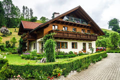 Wonderful alpine classic house Stock Images