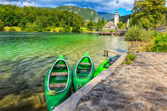 Wonderful alpine lake and colorful boats,Lake Bohinj,Slovenia,Europe Stock Photos