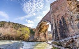 Wonderful ancient bridge over a creek.  Royalty Free Stock Photos
