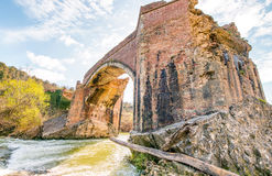 Wonderful ancient bridge over a creek.  Royalty Free Stock Photography