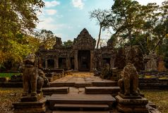 Temple in Angkor Archaeological Site front view. Wonderful ancient temple in Angkor with lion statues at front stock images