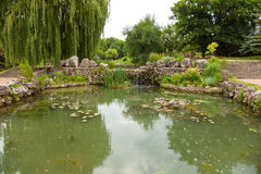Wonderful artificial pond in city park Stock Images