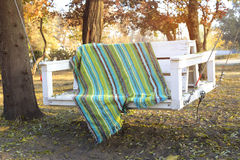 Wonderful autumn landscape.  Scenic swing, covered with colored Royalty Free Stock Photography