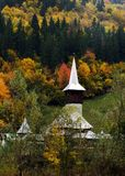 Small Wooden church from Maramures, Romania. Wonderful autumn landscape with wooden church in Viseul de Sus, Maramures, Romania Stock Image